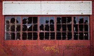 Broken windows on an old brick factory